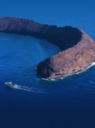 A private charter and lone yacht Leilani entering the Molokini crater.