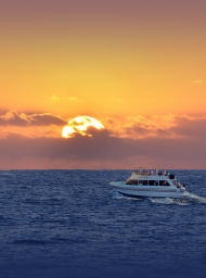 Leilani yacht cruising across the Hawaiian Pacific ocean on a Maui Sunset cruise.