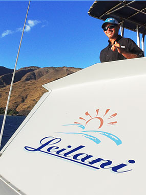 Leilani yacht captain steering the boat.