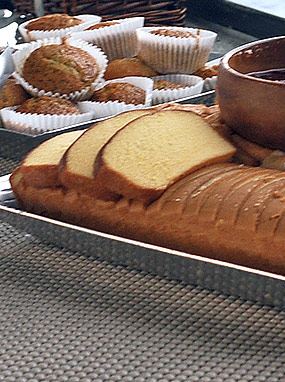 Fresh food spread of bread and muffins/
